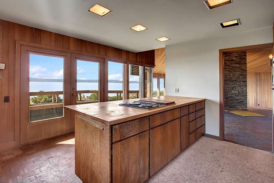 Kitchen of 11065 Arroyo Beach Place S.W., in Arbor Heights. The 2,950-square-foot home, built in 1977, has four bedrooms, 2.5 bathrooms, wood walls, vaulted wood ceilings, two stone fireplaces, walls of windows overlooking Puget Sound, a rec room, decks, patios and a boat ramp on half an acre with 72 feet of waterfront. It's listed for $1.5 million. Want to see it? There's an open house scheduled from noon to 4 p.m. on Sunday. Photo: Courtesy David Katt/Prudential Northwest Realty Associates