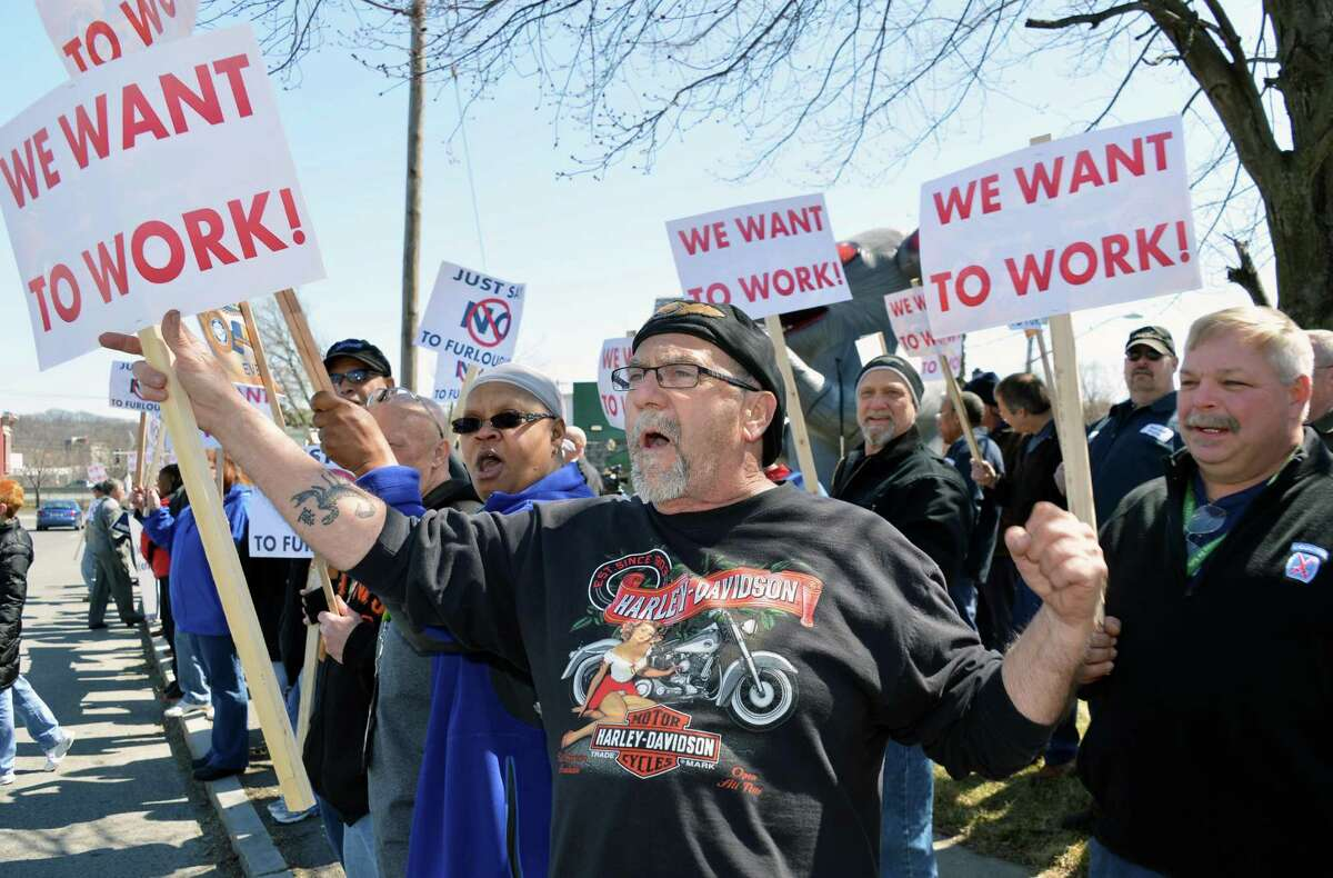 Arsenal worker Allan Dupuis, center, joins local Labor leaders, politicians and other National Federation of Federal Employees (NFFE-IAMAW #2109) rallying to fight back against the federal furloughs outside the Watervliet Arsenal Thursday April 4, 2013. (John Carl D'Annibale / Times Union)