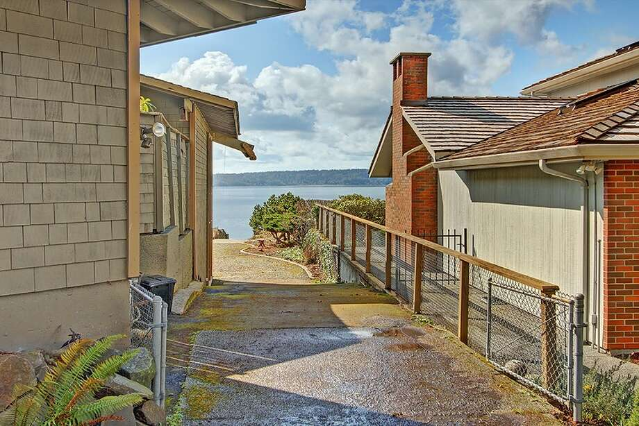 Boat ramp of 11065 Arroyo Beach Place S.W., in Arbor Heights. The 2,950-square-foot home, built in 1977, has four bedrooms, 2.5 bathrooms, wood walls, vaulted wood ceilings, two stone fireplaces, walls of windows overlooking Puget Sound, a rec room, decks and patios on half an acre with 72 feet of waterfront. It's listed for $1.5 million. Want to see it? There's an open house scheduled from noon to 4 p.m. on Sunday. Photo: Courtesy David Katt/Prudential Northwest Realty Associates