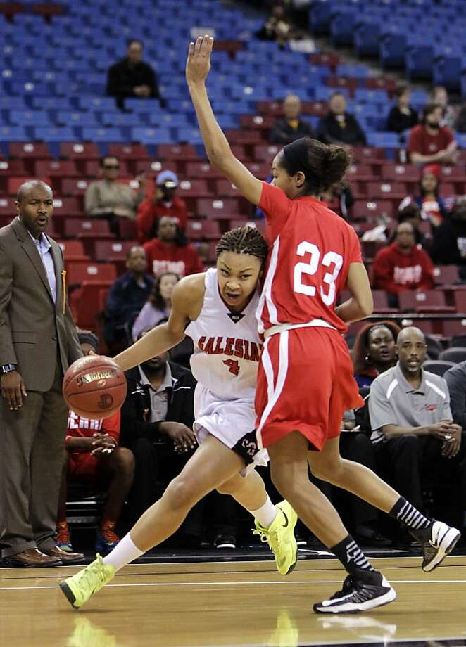 Salesian's Mariya Moore, shown playing Serra-Gardena in the 2013 Div. IV state title game, is the reigning Player of the Year. Photo: Rich Pedroncelli, Associated Press
