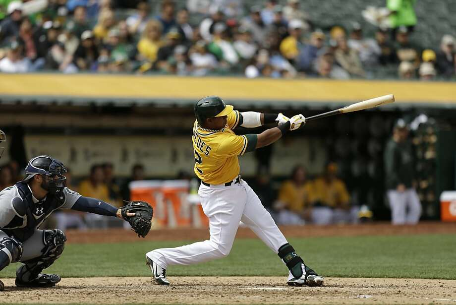 Oakland Athletics' Yoenis Cespedes follows through on his swing after a two run home run hit off Seattle Mariners' Brandon Maurer in the sixth inning of a baseball game Thursday, April 4, 2013, in Oakland, Calif. (AP Photo/Ben Margot) Photo: Ben Margot, Associated Press