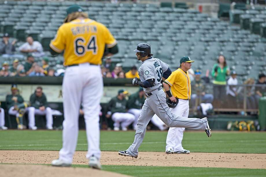 OAKLAND, CA - APRIL 04: Michael Morse #38 of the Seattle Mariners rounds the bases after hitting a home run off of A.J. Griffin #64 of the Oakland Athletics during the sixth inning at O.co Coliseum on April 4, 2013 in Oakland, California. The Oakland Athletics defeated the Seattle Mariners 8-2. (Photo by Jason O. Watson/Getty Images) Photo: Jason O. Watson, Getty Images