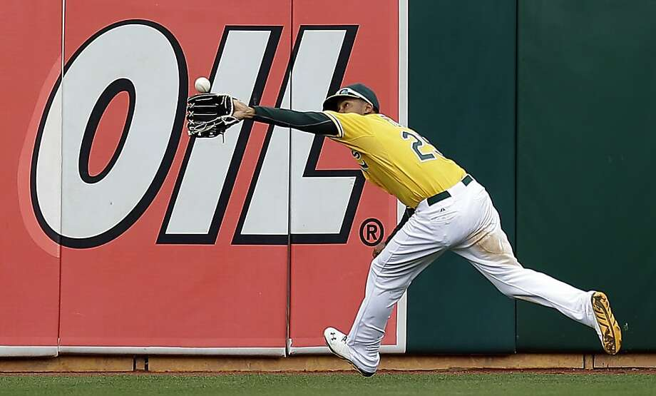 Oakland Athletics Chris Young catches a ball hit by Seattle Mariners' Dustin Ackley in the eighth inning of a baseball game, Thursday, April 4, 2013, in Oakland, Calif. (AP Photo/Ben Margot) Photo: Ben Margot, Associated Press