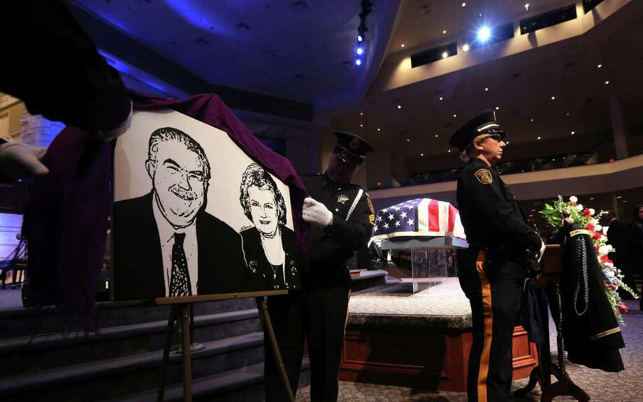 An image of Kaufman County District Attorney Mike McLelland and his wife, Cynthia is unveiled before a memorial services in Mesquite, Texas, Thursday, April 4, 2013. Photo: LM Otero, Associated Press / AP