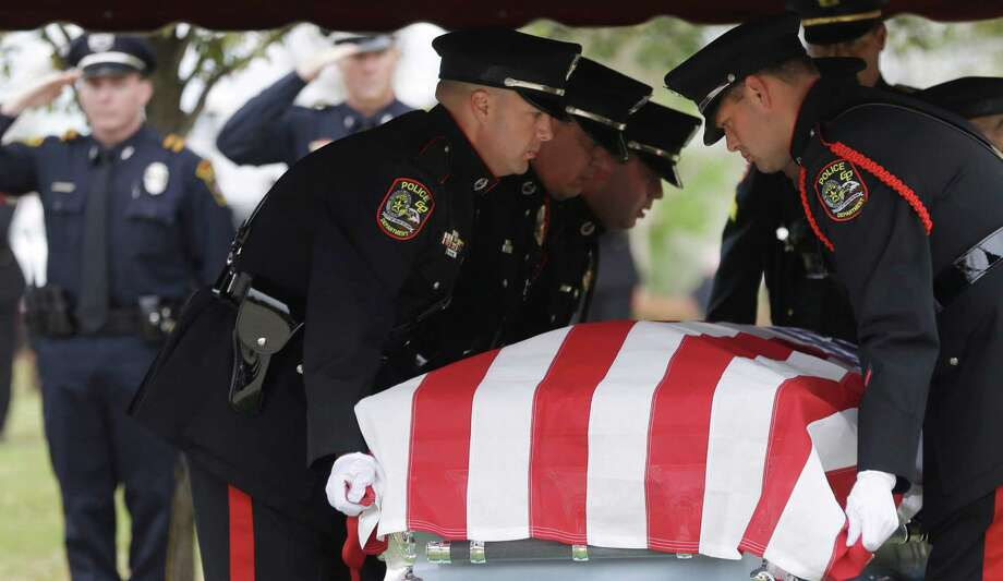 An honor guard moves the remains of Kaufman County District Attorney Mike McLelland and his wife, Cynthia after a memorial services in Mesquite, Texas, Thursday, April 4, 2013. Her remains were cremated and placed inside the coffin with the body of her husband. Photo: LM Otero, Associated Press / AP