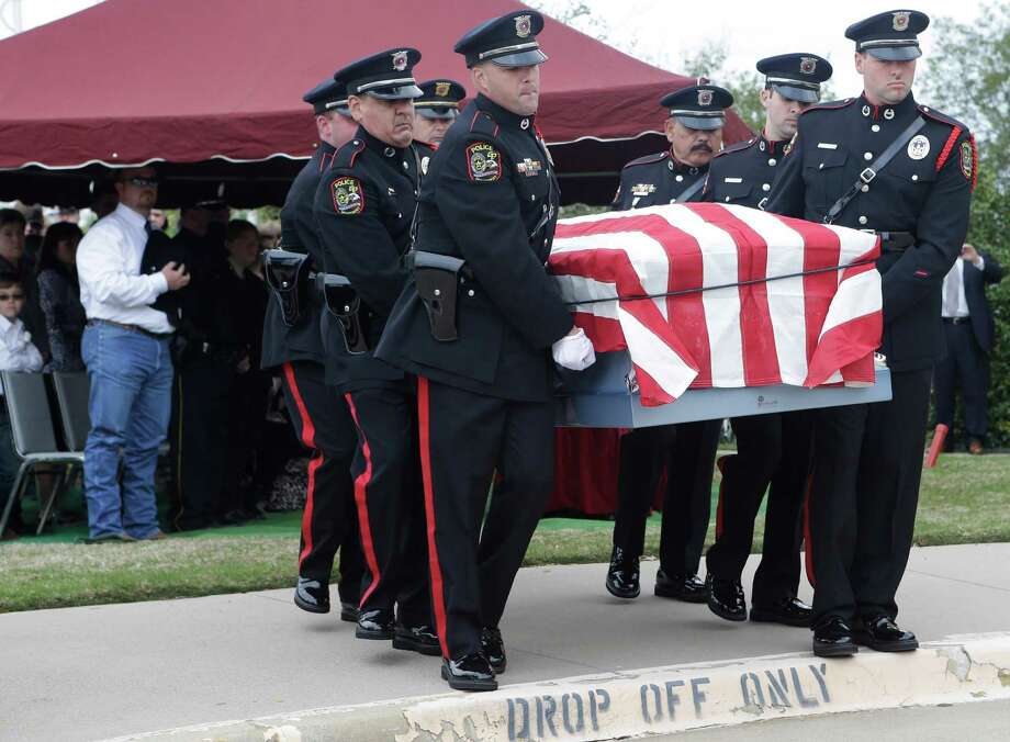An honor guard moves the remains of Kaufman County District Attorney Mike McLelland and his wife, Cynthia after a memorial services in Mesquite, Texas, Thursday, April 4, 2013. Photo: LM Otero, Associated Press / AP