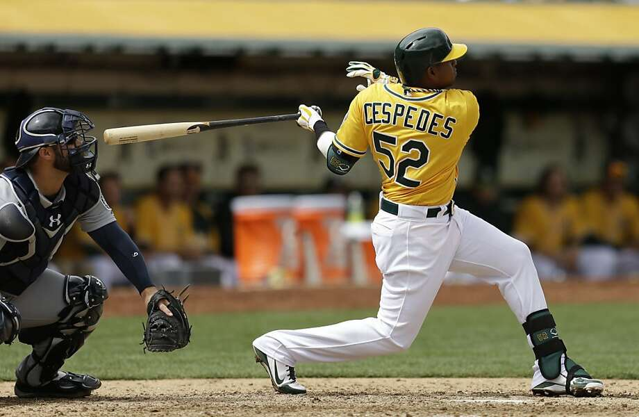 Oakland Athletics' Yoenis Cespedes hits 2-run home run off Seattle Mariners pitcher Brandon Maurer during the sixth inning of a baseball game, Thursday, April 4, 2013, in Oakland, Calif. (AP Photo/Ben Margot) Photo: Ben Margot, Associated Press