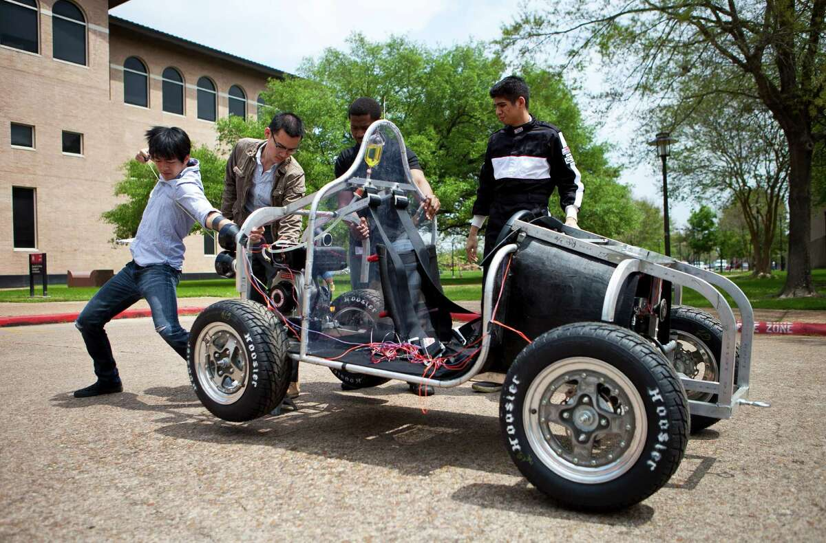 Brian Liu, a University of Houston student, starts up a vehicle he and his teammates plan to enter in the Shell Eco-marathon.