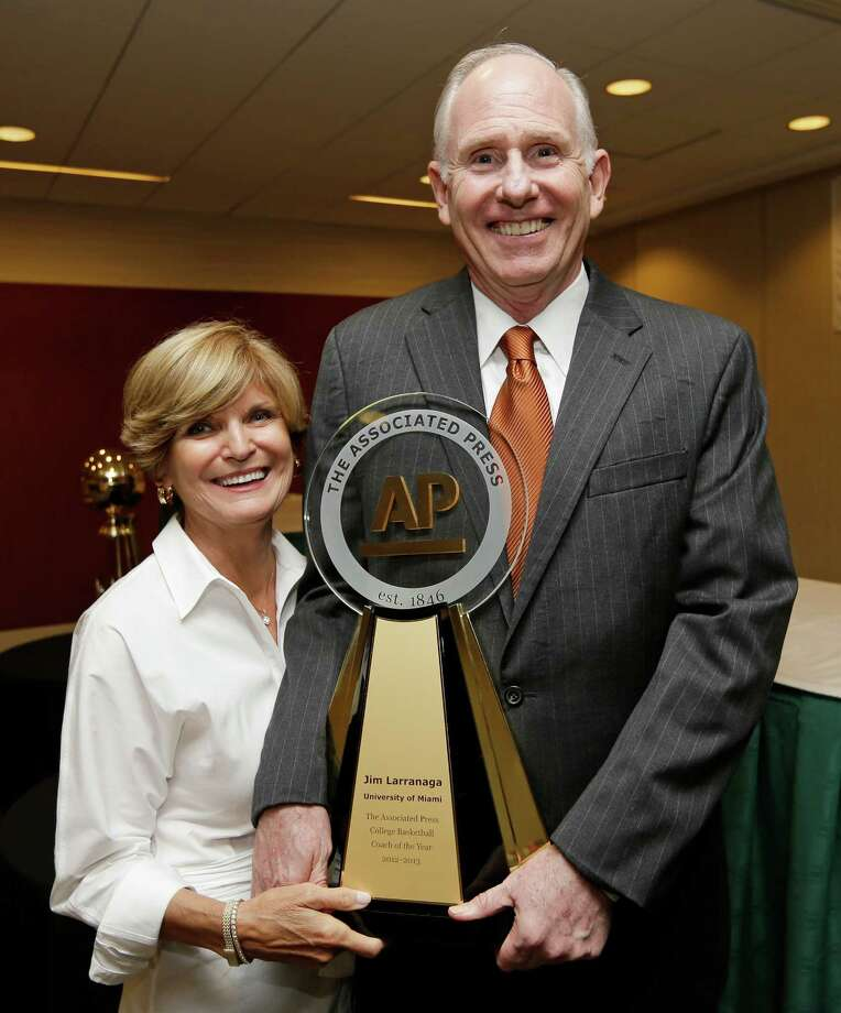 Miami coach Jim Larranaga and his wife Liz pose with the trophy after he was introduced as The Associated Press college basketball coach of the year on Thursday, April 4, 2013, in Atlanta. Larranaga led Miami to the Atlantic Coast Conference regular season and tournament titles and a No. 2 ranking. (AP Photo/John Bazemore) Photo: John Bazemore, STF / AP