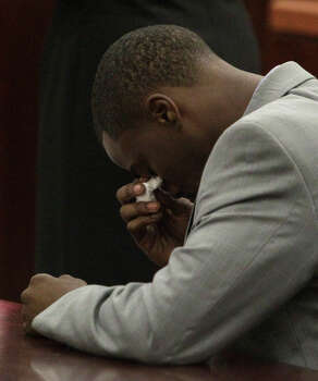 Chad Holley wipes his eyes Thursday at the Harris County Criminal Courthouse, where he got six months in jail and seven years probation for burglary. Photo: Melissa Phillip, Staff / © 2013  Houston Chronicle