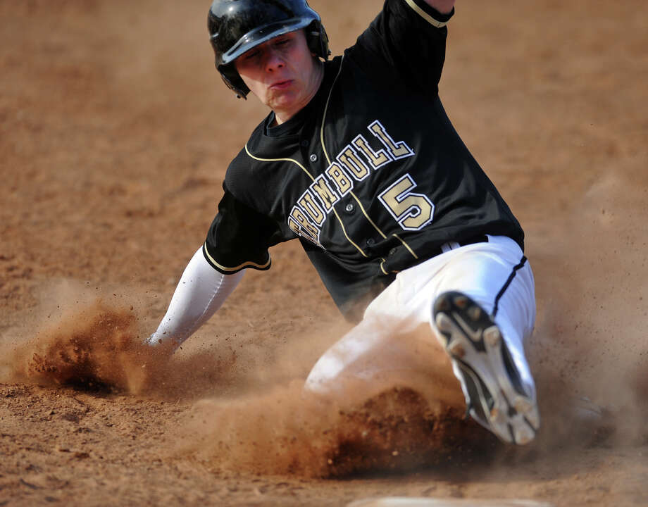 Trumbull's Willy Velez slides into third base, during boys bsaeball action against Bunnell in Stratford, Conn. on Thursday April 4, 2013. Photo: Christian Abraham / Connecticut Post