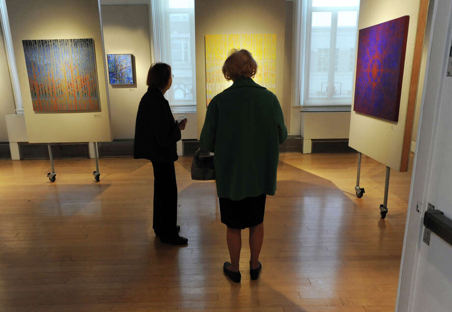 "Elinor Appleton, left, and Barbara Wilson, both of Greenwich, view works during the Greenwich Arts Council opening reception for the exhibition ""Constructions, Paintings & Drawings,""  by husband and wife artists, Gail and Ken Resen of Mamaroneck, N.Y., at the council's Bendheim Gallery in Greenwich, Thursday, April 4, 2013.Their exhibit runs through May 18. Gallery hours are Monday through Friday, 10 a.m. to 5 p.m., and Saturday and Sunday, noon to 4 p.m.  Admission is free. For more information, call 203-862-6751. Photo: Bob Luckey / Greenwich Time"