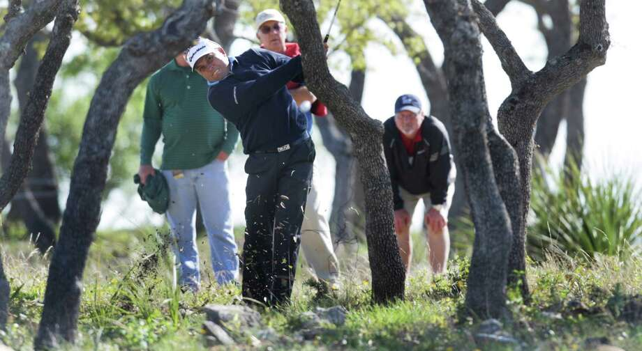 Scott Gardiner hits out of the woods on the 18th hole during the first round of the Valero Texas Open Thursday April 4, 2013. Photo: Bob Owen, Express-News / ©2013 San Antonio Express-News