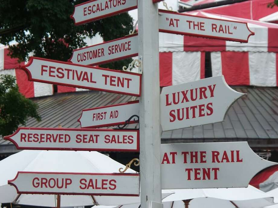 The signs of Saratoga racetrack directing patrons are painted in Saratoga's traditional colors. (Lora Como)