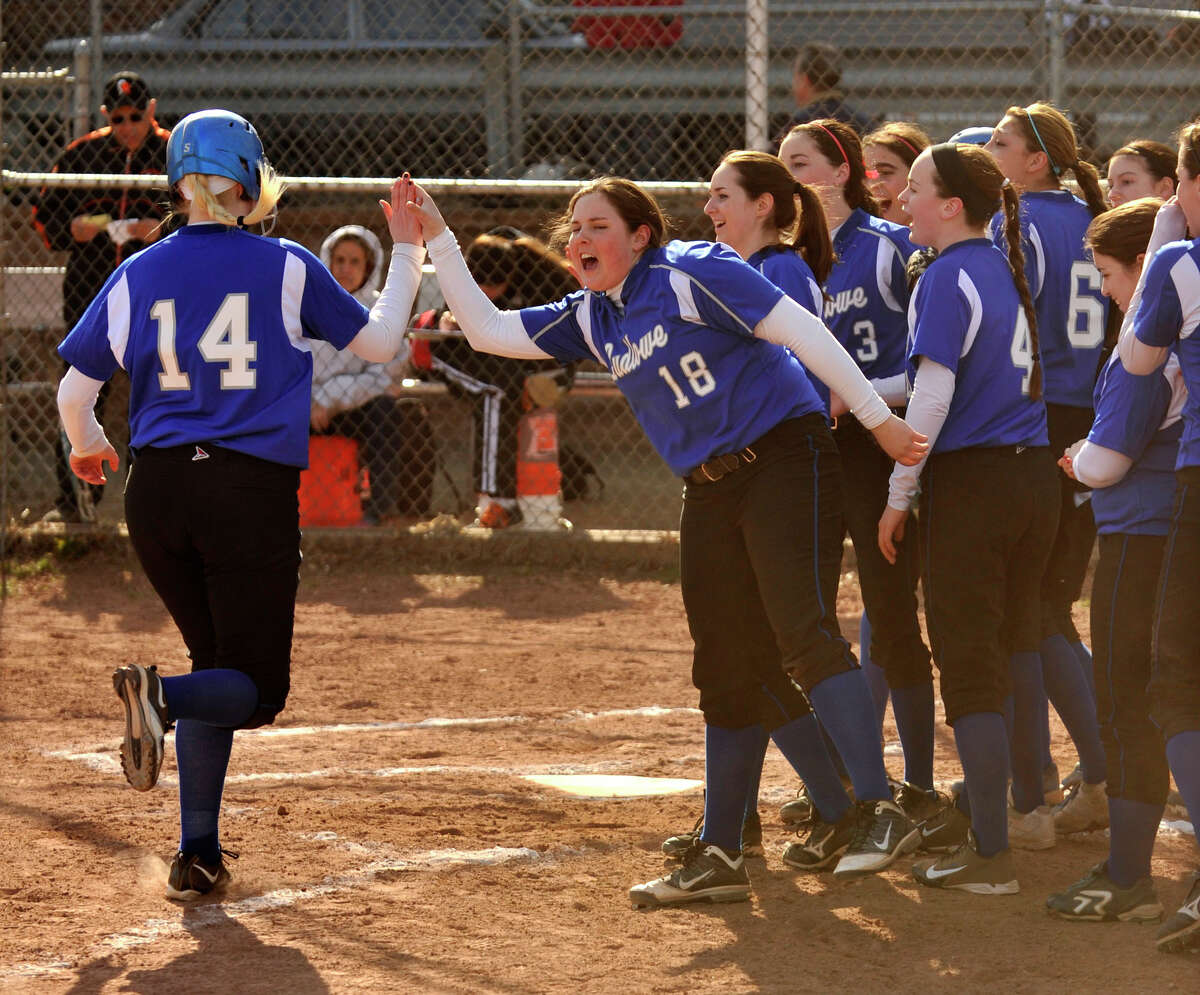 Fairfield Ludlowe's Nickey Tygesen is celebrated by her teammates after Tygesen hit a home run against Stamford at Stamford High School on Thursday, April 4, 2013. Fairfield Ludlowe won, 7-2.