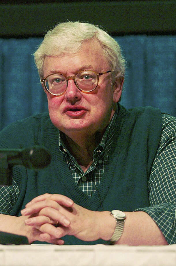 "** FILE ** Film critic Roger Ebert speaks about the movie ""Chinatown"" during his Shot by Shot film workshop at the 15th Annual Virginia Film Festival, in this, Oct. 26, 2002 file photo, at the Regal Theatre in Charlottesville, Va. Ebert is recuperating from followup surgery to his treatment for papillary cancer, one of the most common and curable types of thyroid cancer.     The 60-year-old movie reviewer for the Chicago Sun-Times and on television underwent the procedure Thursday, Feb. 6, 2003 at Northwestern Memorial Hospital, in Chicago.  (AP Photo/The Daily Progress, Andrew Shurtleff, File) Photo: ANDREW SHURTLEFF / THE DAILY PROGRESS"