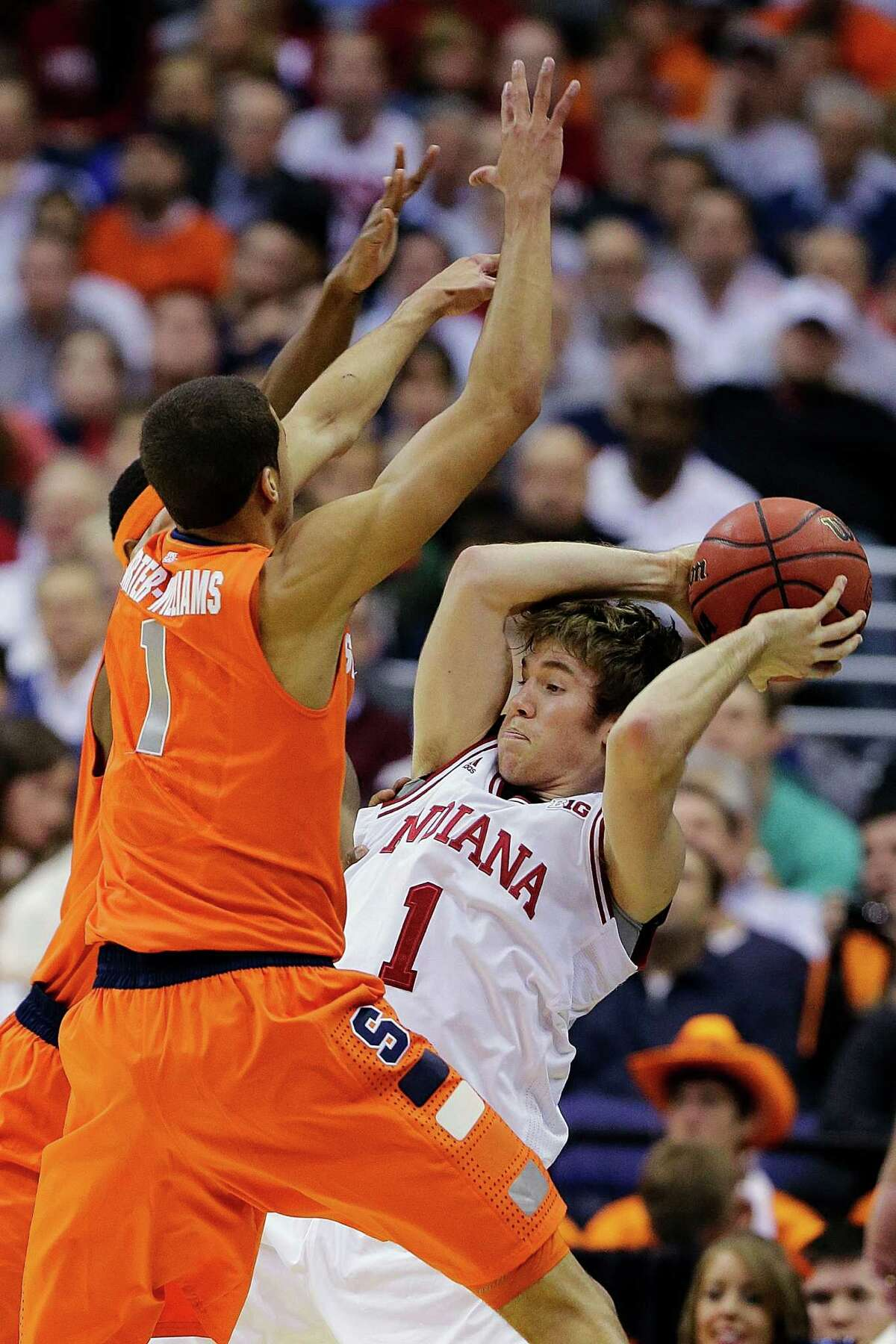 Guard Michael Carter-Williams, who is 6-6, is part of the reason Syracuse's trademark zone defense works so well, as Indiana's Jordan Hulls (1) found out in the East Regional semifinals.