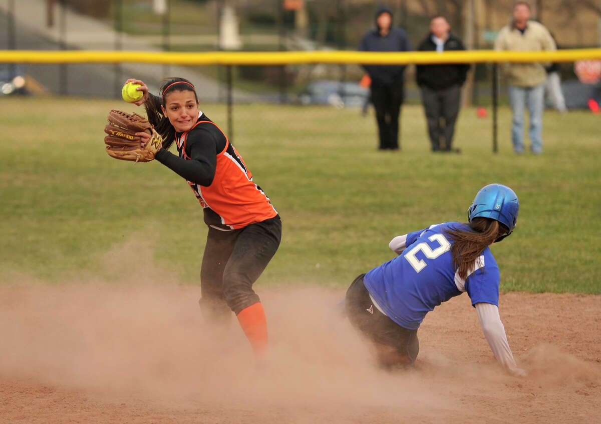 Stamford's Krista Robustelli forces out Farifield Ludlowe's Emily Nelson and looks to throw to first during their game at Stamford High School on Thursday, April 4, 2013. Fairfield Ludlowe won, 7-2.
