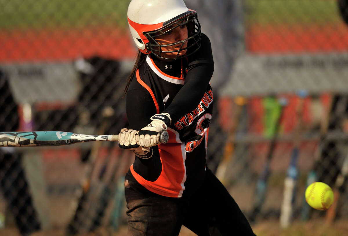 Stamford's Krista Robustelli swings at a ball during the Black Knight's game against Fairfield Ludlowe at Stamford High School on Thursday, April 4, 2013. Fairfield Ludlowe won, 7-2.