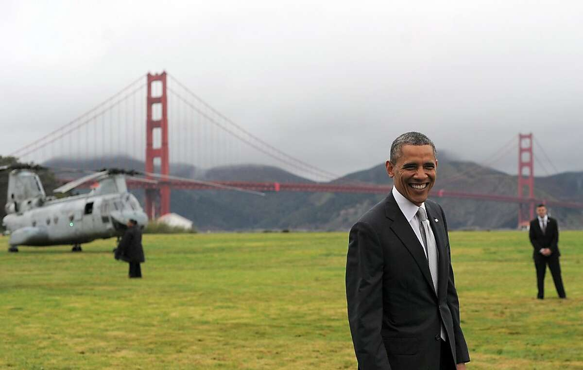 US President Barack Obama smiles before boarding Marine One helicopter from a field overlooking the iconic golden gate bridge in San Francisco, California, on April 4, 2013. Obama is in California to attend two DCCC fund rising events. AFP PHOTO/Jewel SamadJEWEL SAMAD/AFP/Getty Images