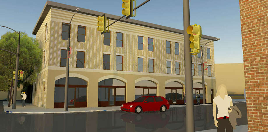 The three-story Henry Terrell Building at Avenue E and North Alamo Street will be restored and converted into 10 apartments, each with one bedroom and one bath, on the second and third floors, and work and retail spaces on the first floor. Photo: Courtesy Uptown Interests