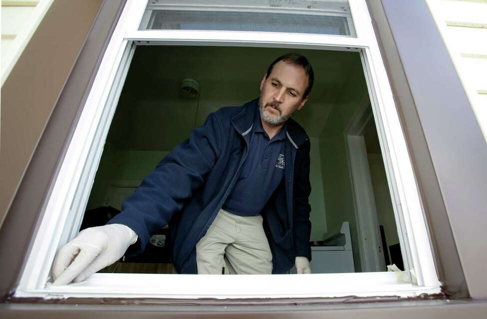 Cuyahoga County Board of Health lead risk assessor Tom Barsa swipes a windowsill Thursday, April 4, 2013, in Lakewood, Ohio. More than half a million U.S. children are now believed to have lead poisoning, roughly twice the previous high estimate, health officials reported Thursday. The increase is the result of the government last year lowering the threshold for lead poisoning, so now more children are considered at risk. (AP Photo/Tony Dejak)