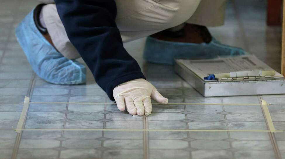 Cuyahoga County Board of Health lead risk assessor Tom Barsa swipes a kitchen floor for lead Thursday, April 4, 2013, in Lakewood, Ohio. More than half a million U.S. children are now believed to have lead poisoning, roughly twice the previous high estimate, health officials reported Thursday. The increase is the result of the government last year lowering the threshold for lead poisoning, so now more children are considered at risk. (AP Photo/Tony Dejak)