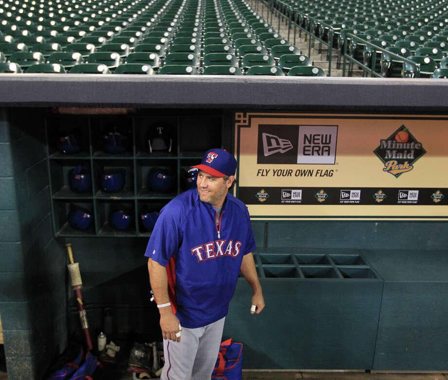 Ranger Lance Berkman in the dugout during batting practice. Photo: Karen Warren, Houston Chronicle / © 2013 Houston Chronicle
