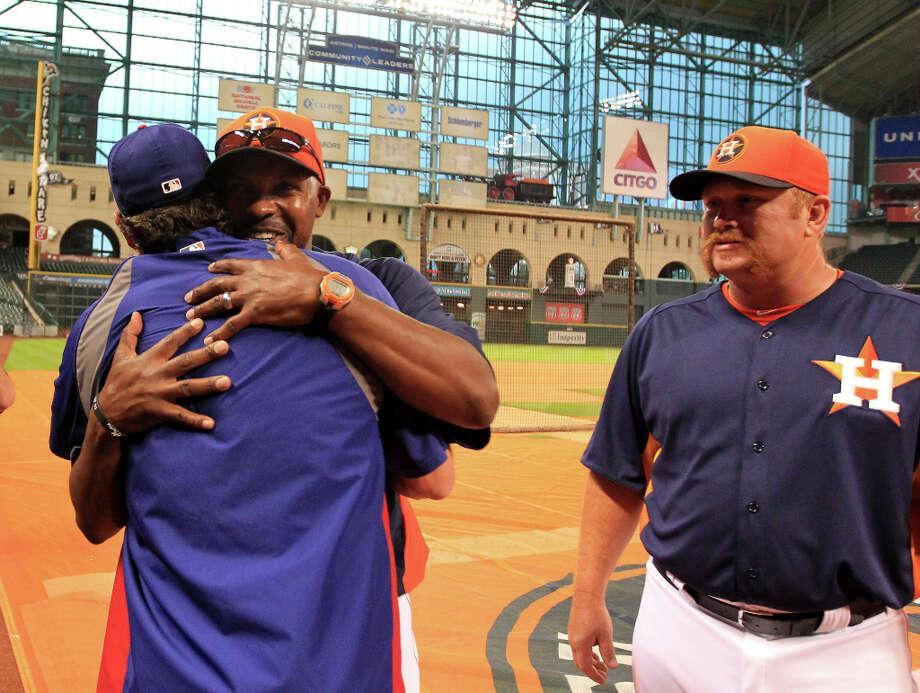 Astros manager Bo Porter (16) hugs former Astro and current Ranger Lance Berkman during batting practice. Photo: Karen Warren, Houston Chronicle / © 2013 Houston Chronicle