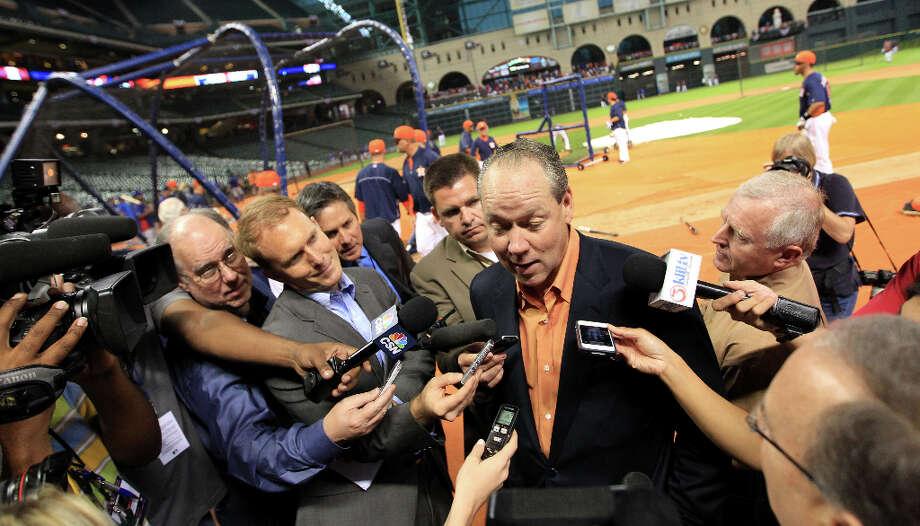 Astros owner Jim Crane talks to the media during batting practice. Photo: Karen Warren, Houston Chronicle / © 2013 Houston Chronicle