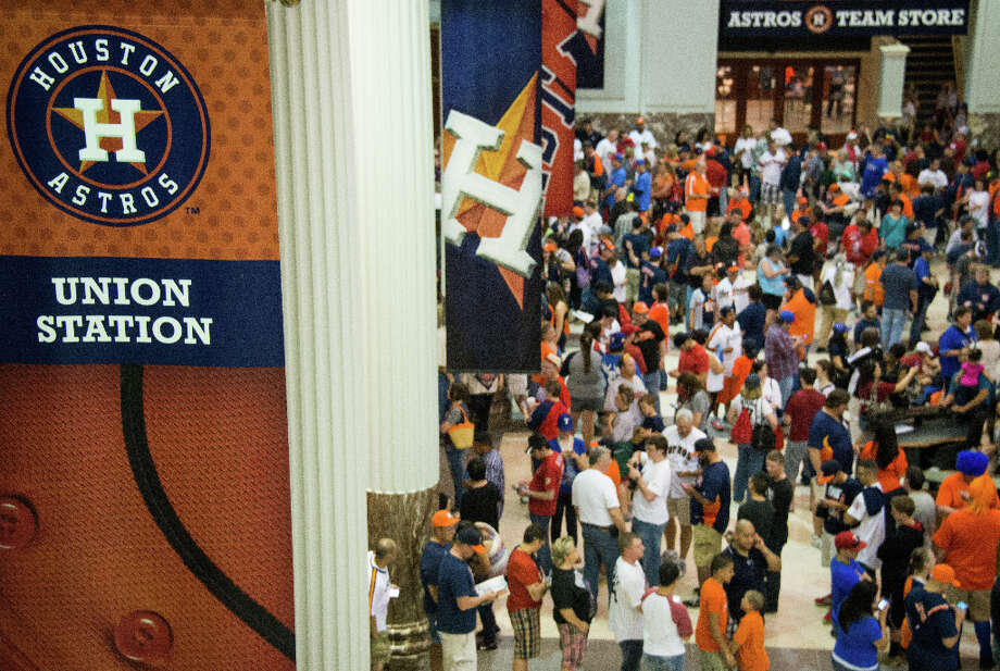 Fans pack the lobby of Union Station waiting for the gates to open before the Astros season opener against the Rangers. Photo: Smiley N. Pool, Houston Chronicle / © 2013  Smiley N. Pool