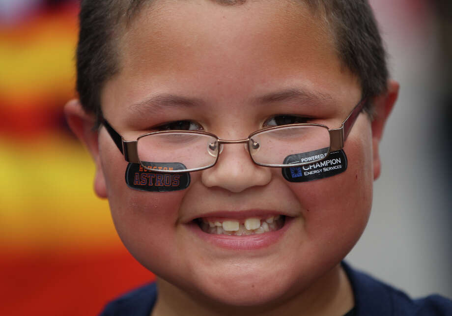 Bailey Casas, 8, smiles during the street festival. Photo: Karen Warren, Houston Chronicle / © 2013 Houston Chronicle