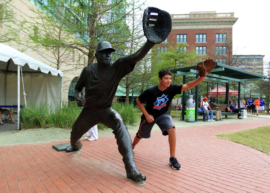 Angel Davila, 15, of Corpus Christi, poses for a photo next to the Jeff Bagwell statue during the street festival on Crawford Street, outside of Minute Maid Park, before the start of Opening Day. Photo: Karen Warren, Houston Chronicle / © 2013 Houston Chronicle