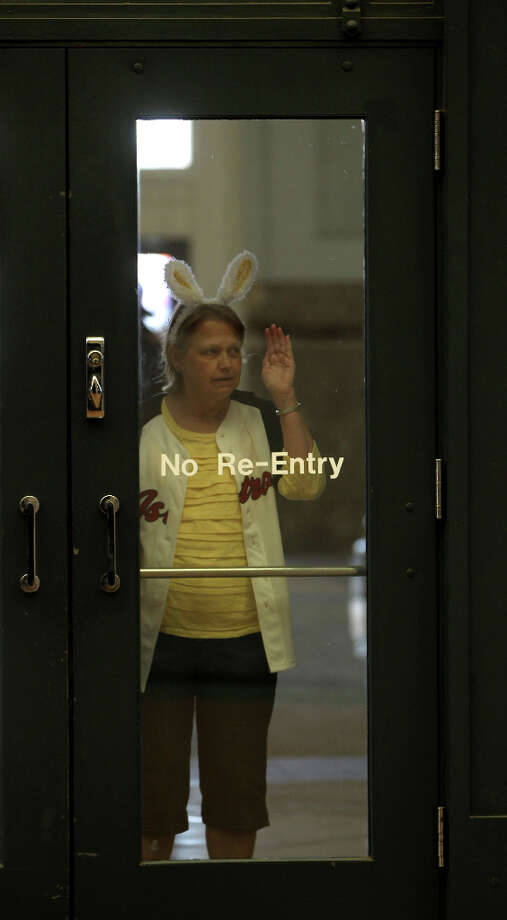 Arlene Diehl, of Magnolia, peeks into the doors of Minute Maid Park before the start of the Opening Day festivities. Photo: Karen Warren, Houston Chronicle / © 2013 Houston Chronicle