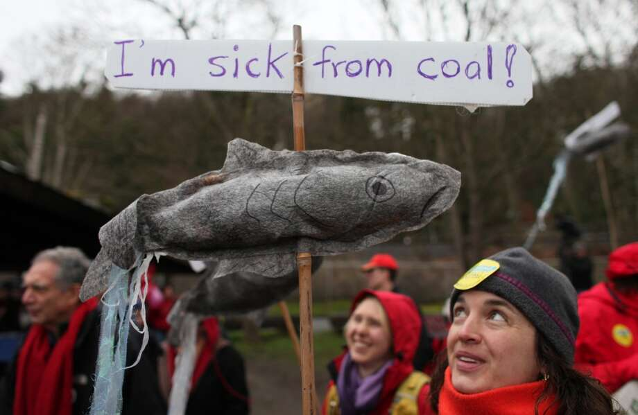 Lenore Bussing carries a sign during a protest against proposed coal trains. Photo: JOSHUA TRUJILLO, SEATTLEPI.COM