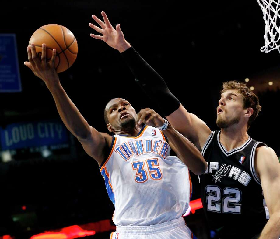 Oklahoma City Thunder forward Kevin Durant (35) shoots in front of Spurs center Tiago Splitter (22) in the first quarter in Oklahoma City, Thursday, April 4, 2013. Photo: Sue Ogrocki, Associated Press / AP