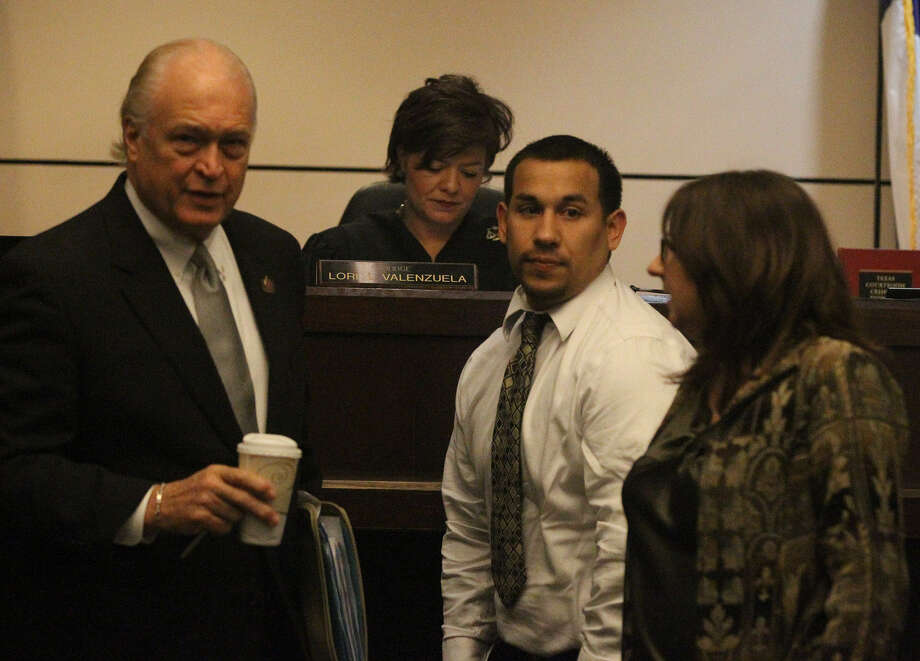 Mark Anthony Garcia (center) appears with attorneys Ed Bartolomei and Linda Corley. Photo: John Davenport / San Antonio Express-News