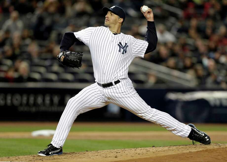 New York Yankees starting pitcher Andy Pettitte delivers in the fifth inning against the Boston Red Sox in a baseball game at Yankee Stadium in New York, Thursday, April 4, 2013. (AP Photo/Kathy Willens) Photo: Kathy Willens