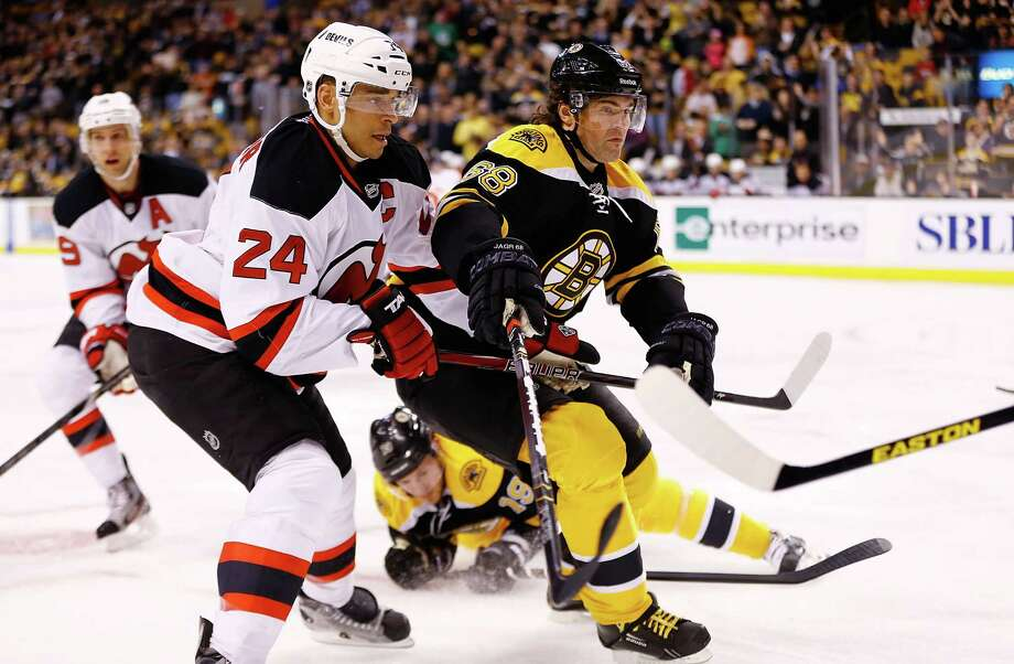 BOSTON, MA - APRIL 4: Jaromir Jagr #68 of the Boston Bruins races to the puck past Bryce Salvador #24 of the New Jersey Devils during the game on April 2, 2013 at TD Garden in Boston, Massachusetts. (Photo by Jared Wickerham/Getty Images) Photo: Jared Wickerham