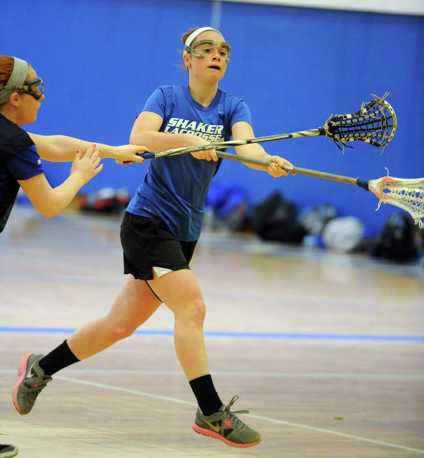 Julia Lennon practices with the Shaker lacrosse team on Wednesday, April 3, 2013 in Latham, N.Y. (Lori Van Buren / Times Union) Photo: Lori Van Buren / 00021828A