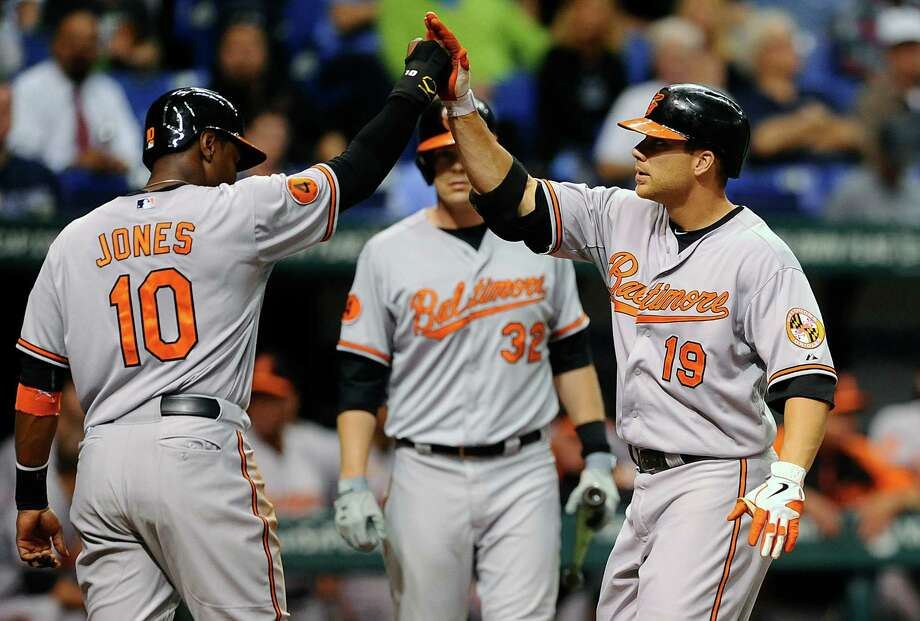 Orioles first baseman Chris Davis, right, celebrates his third home run of the young season Thursday. Photo: Brian Blanco, FRE / FR170107 AP
