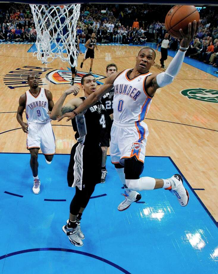 Oklahoma City Thunder guard Russell Westbrook (0) shoots in front of Spurs guard Danny Green (4) in the first quarter in Oklahoma City, Thursday, April 4, 2013. Photo: Sue Ogrocki, Associated Press / AP