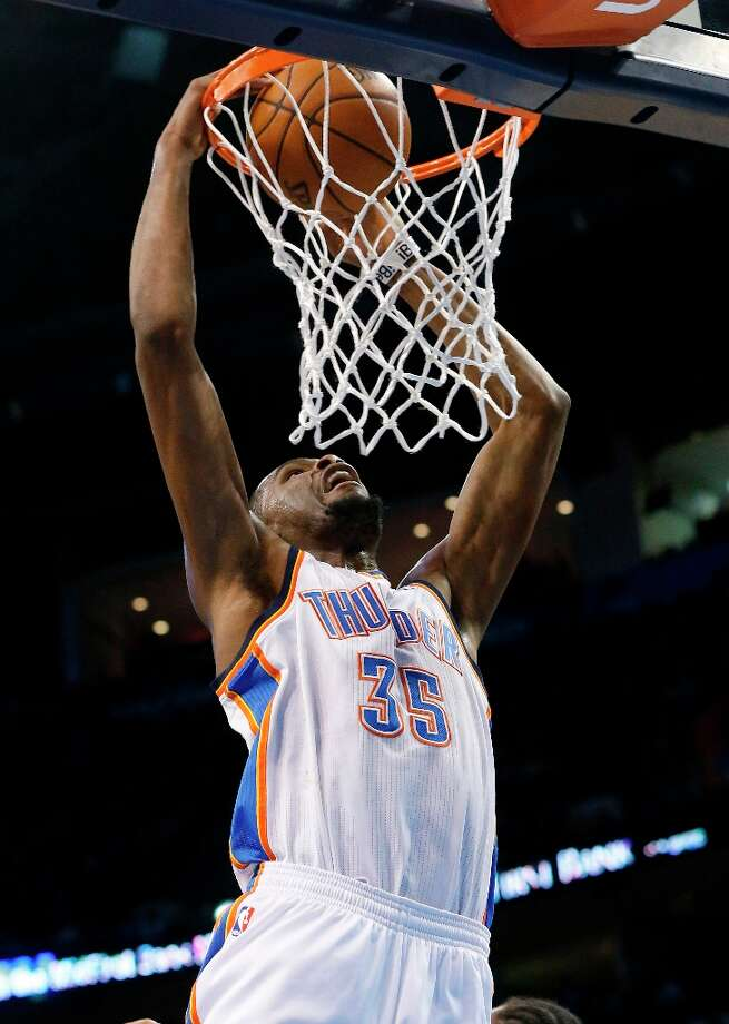 Oklahoma City Thunder forward Kevin Durant dunks against the Spurs in the second quarter in Oklahoma City, Thursday, April 4, 2013. Photo: Sue Ogrocki, Associated Press / AP