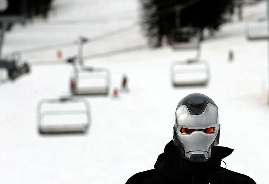 Coeur d'Alene resident Chris Moore wear his superhero mask while skiing Schweitzer Mountain in Sandpoint, Idaho on Thursday, April 4, 2013. Schweitzer extended their ski season through April 14, 2013. (AP Photo/The Spokesman-Review, Kathy Plonka) Photo: Kathy Plonka, Associated Press