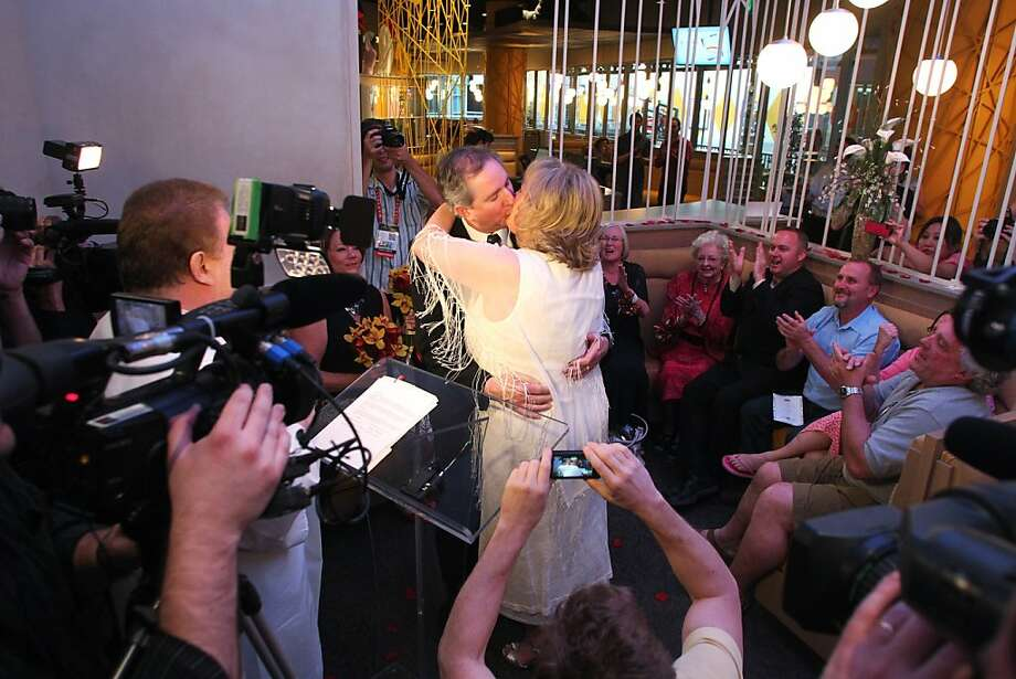 Nancy Levindowski and Steve Keller kiss after exchanging wedding vows at the Denny's restaurant on Fremont Street in Las Vegas, Wednesday, April 4, 2013. (AP Photo/Las Vegas Sun, Sam Morris) Photo: Sam Morris, Associated Press