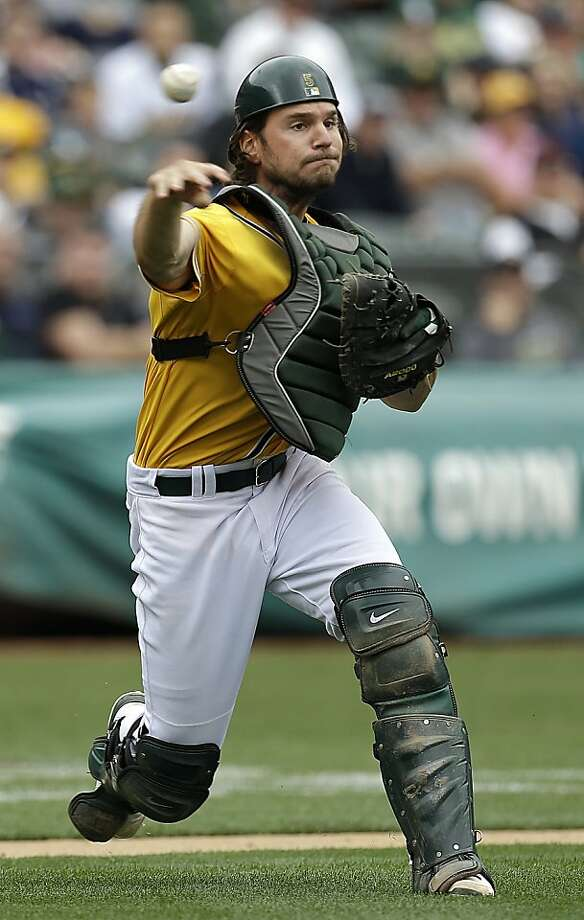 Oakland Athletics catcher John Jaso throws out Seattle Mariners' Robert Andino in the fifth inning of a baseball game Thursday, April 4, 2013, in Oakland, Calif. (AP Photo/Ben Margot) Photo: Ben Margot, Associated Press