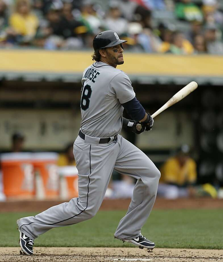 Seattle Mariners' Michael Morse swings for a single against the Oakland Athletics in the fourth inning of a baseball game Thursday, April 4, 2013, in Oakland, Calif. (AP Photo/Ben Margot) Photo: Ben Margot, Associated Press