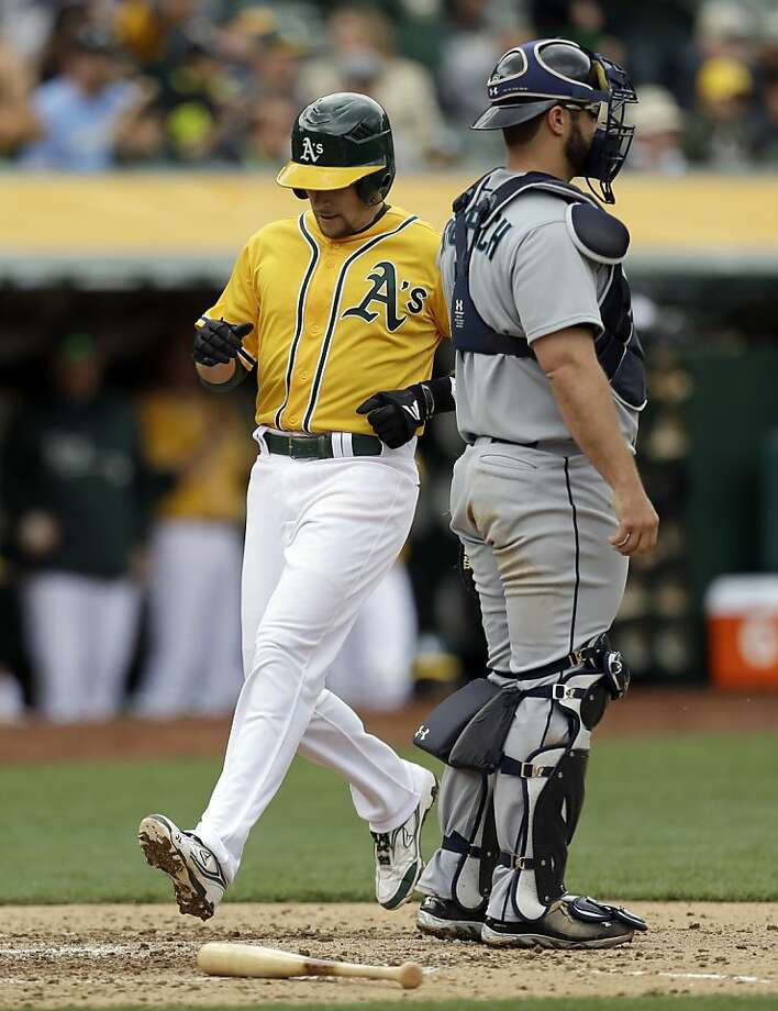 Oakland Athletics' Jed Lowrie scores past Seattle Mariners catcher Kelly Shoppach in the sixth inning of a baseball game Thursday, April 4, 2013, in Oakland, Calif. (AP Photo/Ben Margot) Photo: Ben Margot, Associated Press