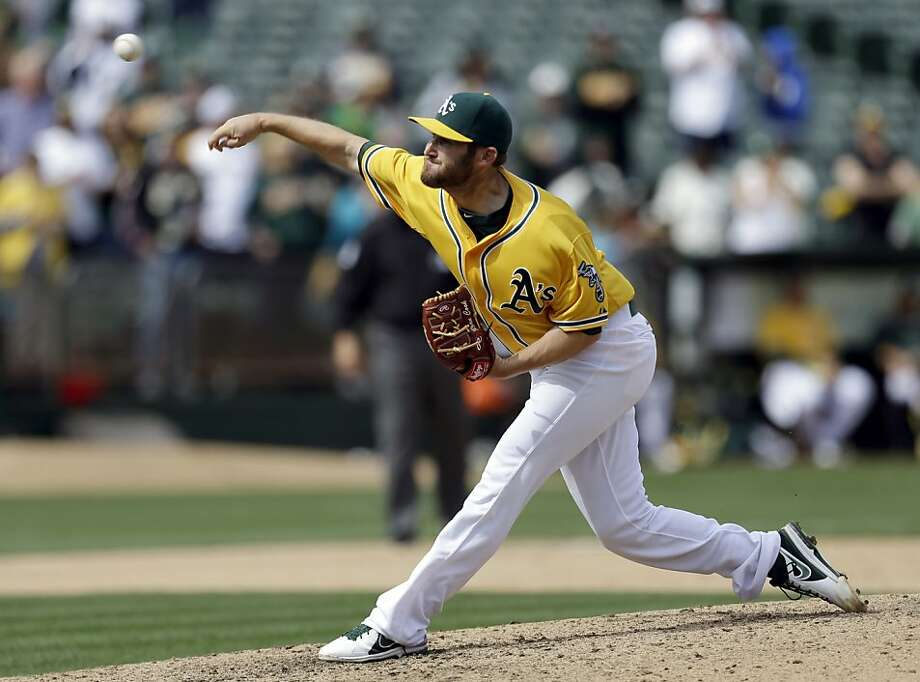 Oakland Athletics' Ryan Cook works against the Seattle Mariners in the ninth inning of a baseball game, Thursday, April 4, 2013, in Oakland, Calif. (AP Photo/Ben Margot) Photo: Ben Margot, Associated Press