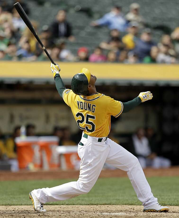 Oakland Athletics' Chris Young pops up a ball in the eighth inning of a baseball game against the Seattle Mariners Thursday, April 4, 2013, in Oakland, Calif. (AP Photo/Ben Margot) Photo: Ben Margot, Associated Press